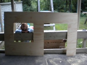 a large piece of plywood with two squares cut out
