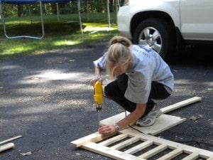 a woman making a wood railing