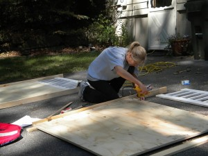 A woman drilling pieces of wood together