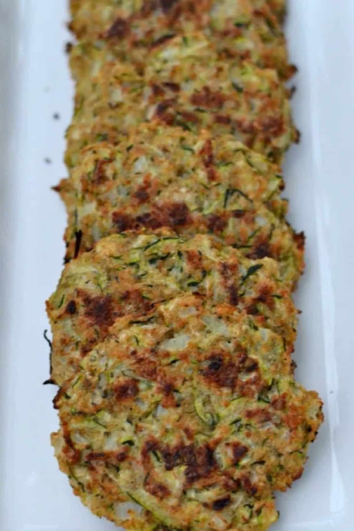 Baked Zucchini Cakes are a much healthier option to fried with the same crispiness. So quick to make and loaded with flavor, they are a great new way to serve this favorite veggie.