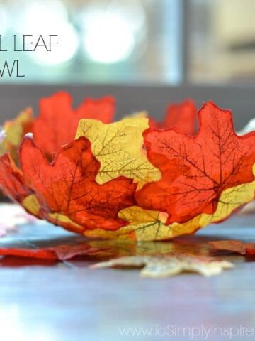 Fall colored leaves in the shape of a bowl with text overlay - DIY fall leaf bowl