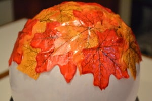 artificial fall leaves on a white balloon