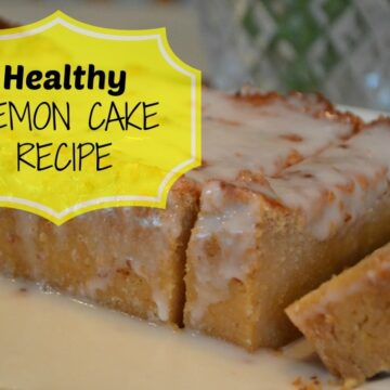 glazed lemon cake loaf with two slices cut on a white plate