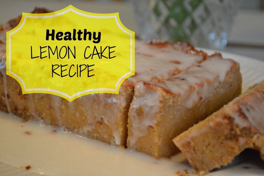 glazed lemon cake with two slices cut