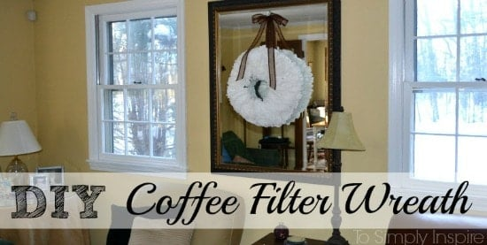 a white coffee filter wreath on a big mirror