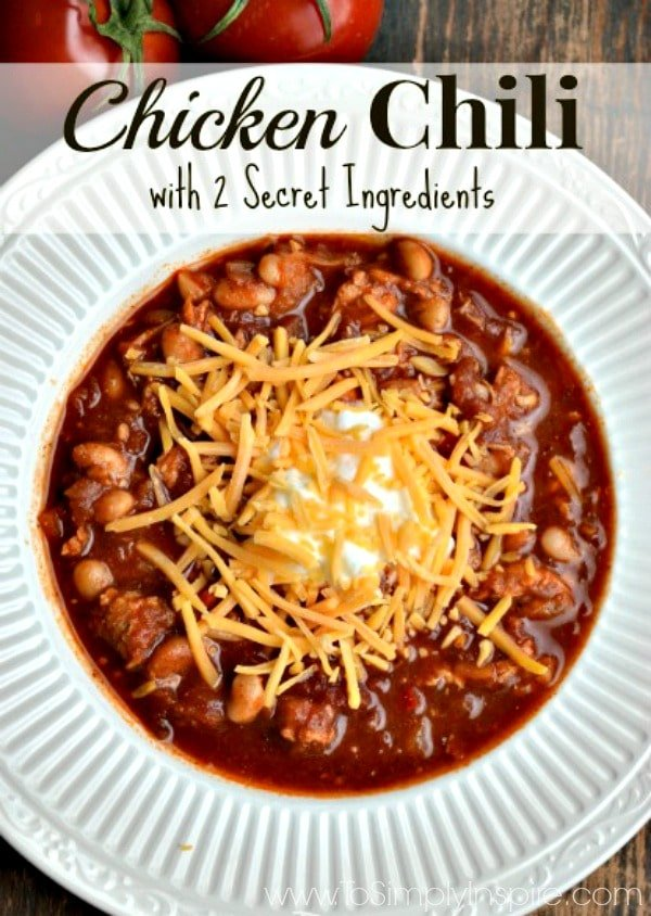 Chicken Chili Recipe in a white bowl with cheese top - Recipe at www.ToSimplyInspire.com