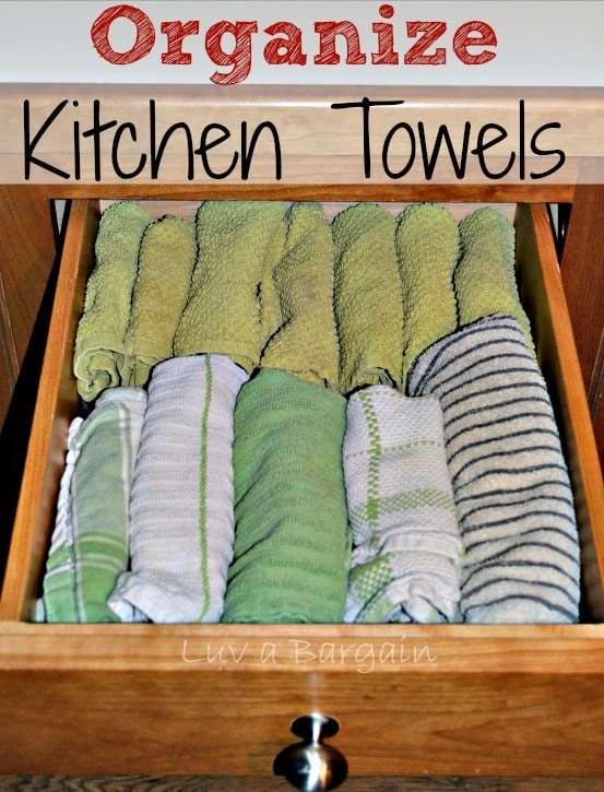 a drawer full of rolled dish towels.