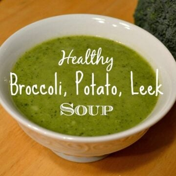 a white bowl of creamy broccoli soup