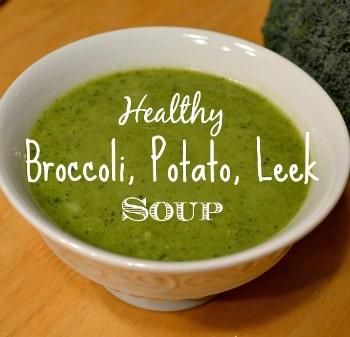 a white bowl of creamy broccoli soup