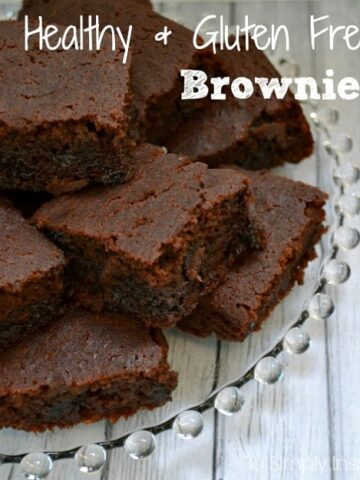 Healthy Gluten Free Brownies stacked on a glass plate