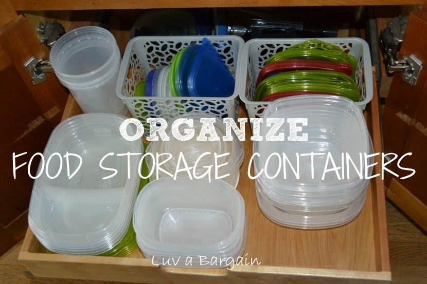a cabinet drawer with plastic containers and baskets