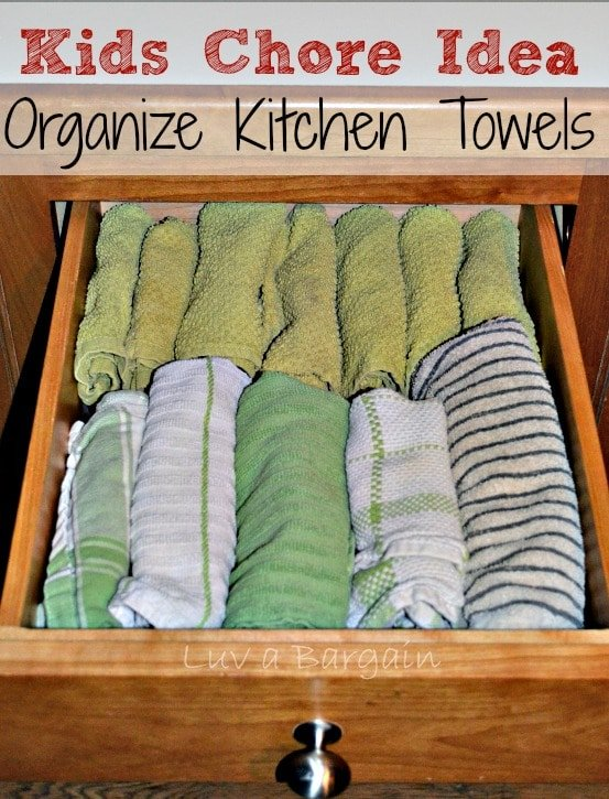 a drawer full of rolled dish towels