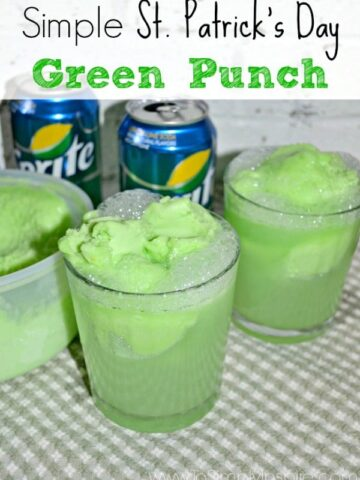 A cup green punch with scoops of sherbet on a green checkered towel