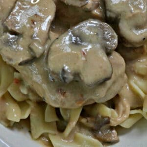 cooked mushroom and chicken in a cream sauce over egg noodles