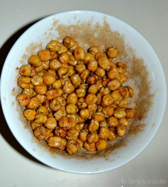 Uncooked Chickpeas mixed in maple cinnamon mixture