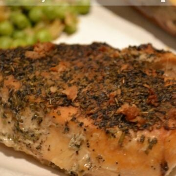 chicken breasts topped with dried rosemary and garlic