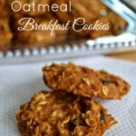 pumpkin oatmeal cookies on a white napkin with a plateful in the background