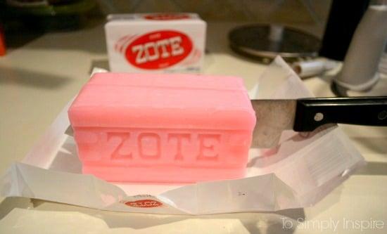 A close up of a gar of pink zote soap