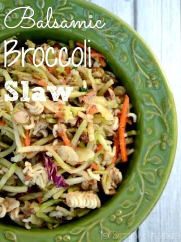 "Balsamic Broccoli Slaw recipe served in a green bowl with tex overlay ""Balsamic Broccoli Slaw""."