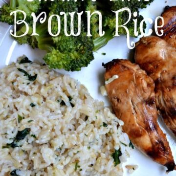 brown rice, broccoli and grilled chicken tenders on a white plate