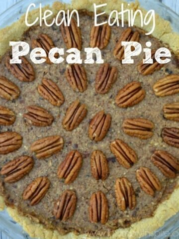 pecan pie topped with pecan halves in a pattern on a grey table