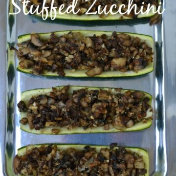 hollowed out zucchini halves filled with sautéed mushrooms on a silver plate
