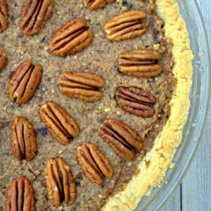 closeup of pecan pie with pecans halves all over the top