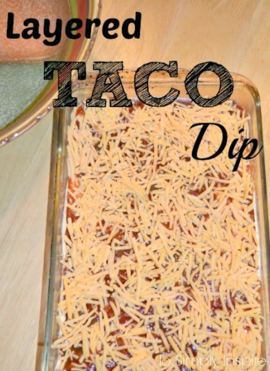 Layered Taco Dip in a serving bowl with text overlay