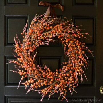 Orange and Red Berry Fall Wreath on a Black Door