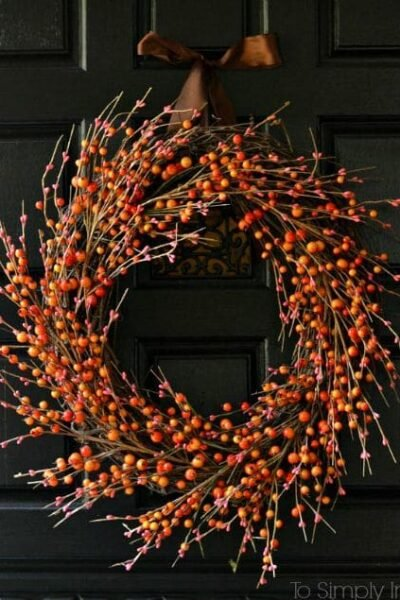 Orange Berry Wreath on a black door