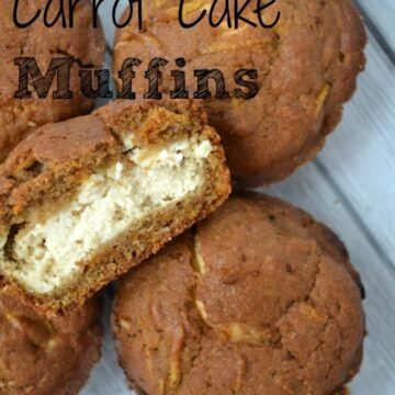 carrot cake muffins with one cut in half and filled with cream cheese frosting