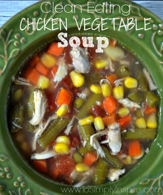 "Chicken Vegetable Soup in a green bowl with test overlay ""clean eating Chicken Vegetable Soup"""