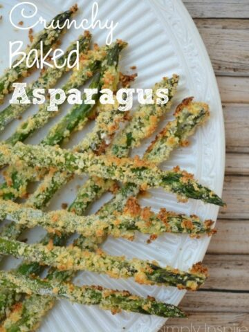 asparagus coated in panko breadcrumbs on a white plate