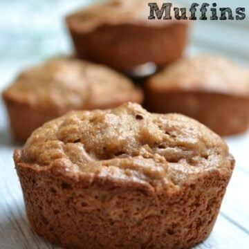 four almond butter muffins on a table