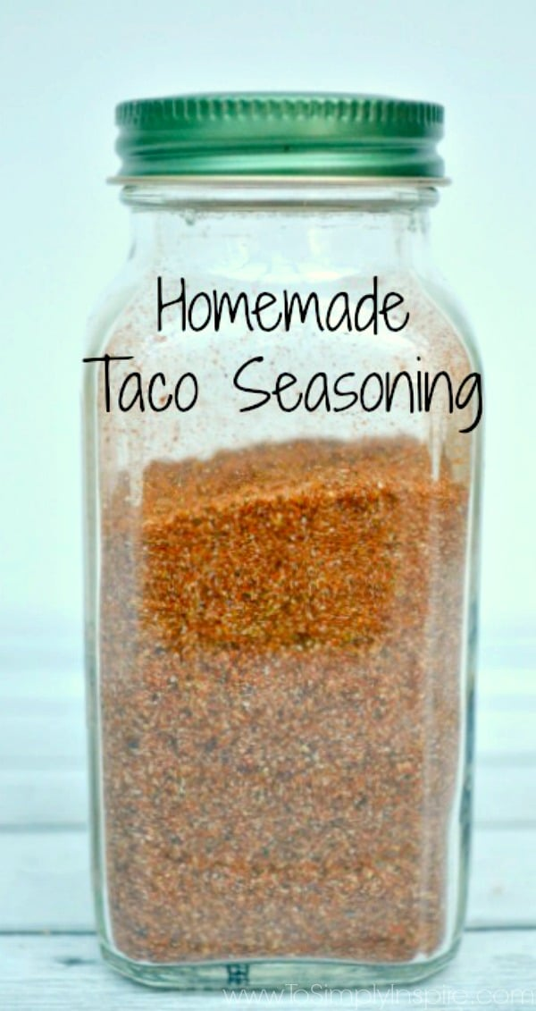 Homemade taco seasoning in a spice jar with text overlay.