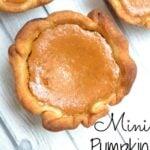 mini pumpkin pie on a grey wood table