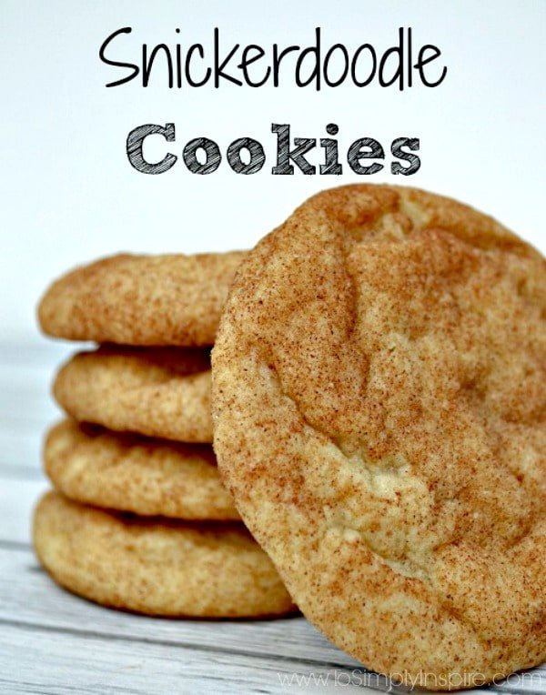 a stack of four Snickerdoodle Cookies with one leaning against the stack
