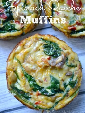 Closeup of Spinach Quiche Muffin with more muffins in the background