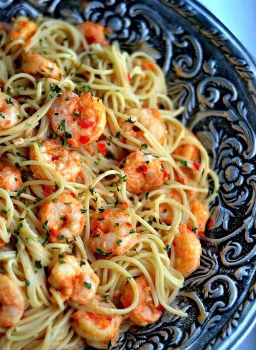 shrimp and pasta in a big silver bowl