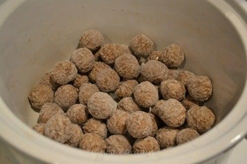 frozen meatballs in a white crockpot