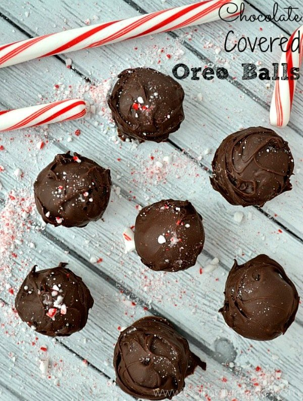 Oreo Balls recipe on a table surrounded by crushed candy canes