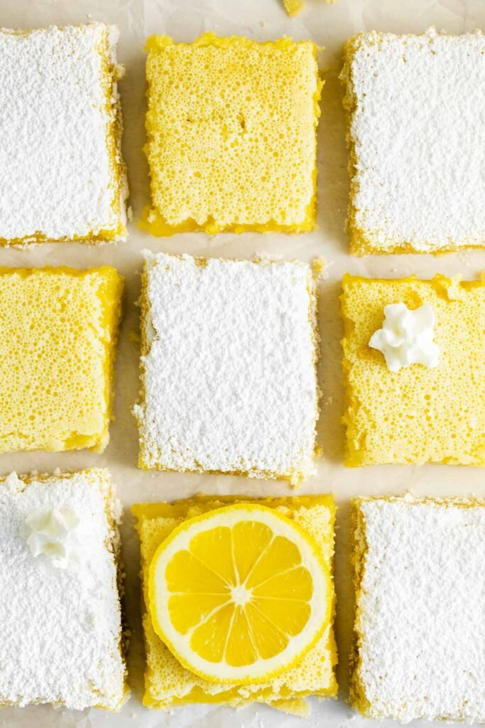 closeup of nine lemon bars some covered with powdered sugar