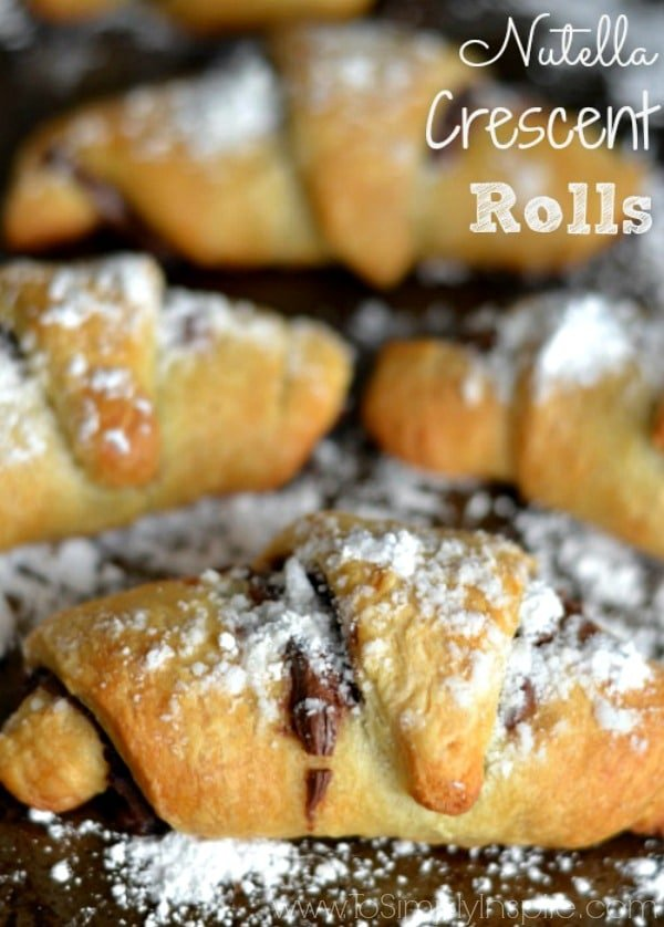 A close up of crescent roll with Nutella and powdered sugar