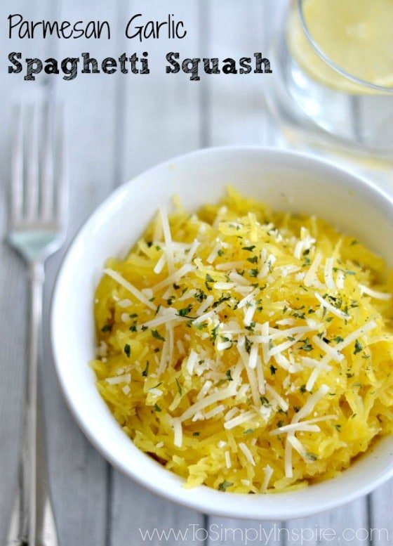 "Closeup of Parmesan Garlic Spaghetti Squash recipe in a white bowl with text overlay ""Parmesan Garlic Spaghetti Squash"""