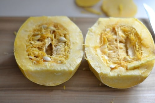 spaghetti squash cut in half on a cutting board