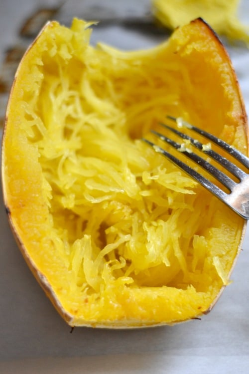 closeup of spaghetti squash with fork shredding inside