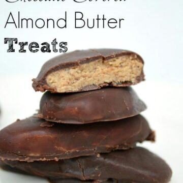 a stack of chocolate covered almond butter treats