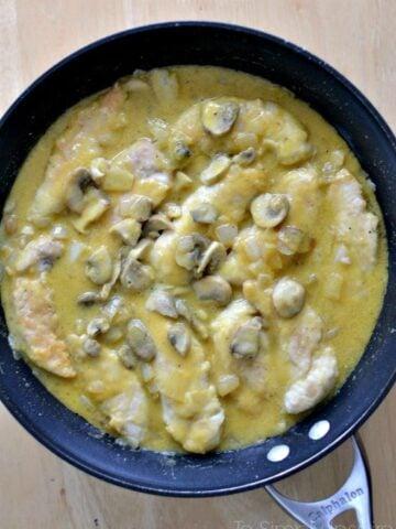 Honey Mustard Chicken with mushrooms recipe in a black pan