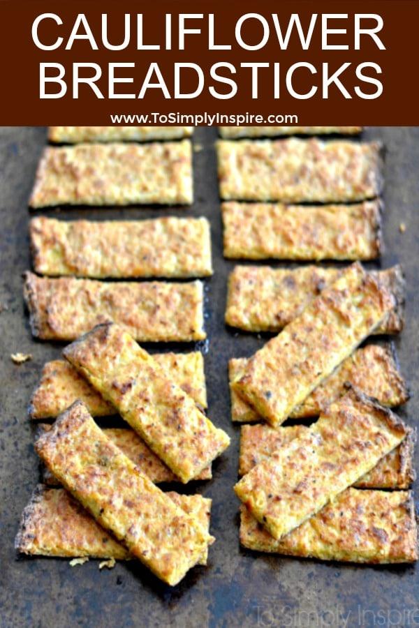 slices of Cauliflower Breadsticks recipe on a baking sheet.