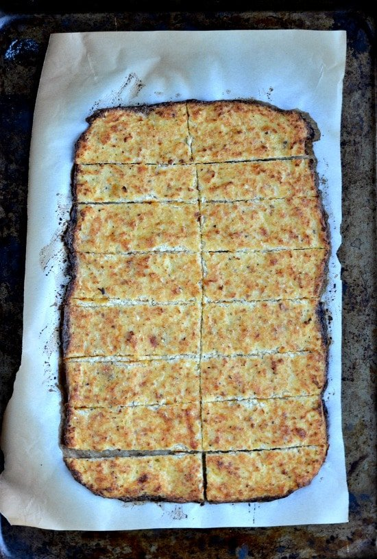 slices of Cauliflower Cheesy Bread on a baking sheet.